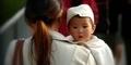 China Akan Denda Perempuan yang Miliki Anak Tanpa Suami