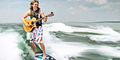 Video Chris Hau Main Gitar Sambil Surfing di Lautan