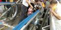 Bocah Tiongkok Tewas Terjepit Eskalator Stasiun