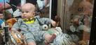 Foto Bayi Terjebak di Dalam Mesin Boneka